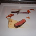 Wagyu beef with potato puree and garlic chip transparency