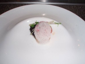 Butter poached lobster with forbidden rice and coconut air