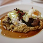 Harris Ranch beef tips with poached eggs and grits