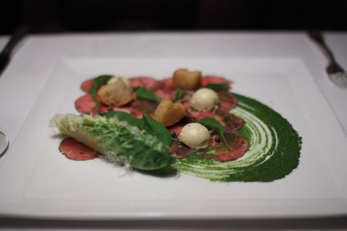 Carpaccio of herb crusted baby lamb with Caesar salad ice cream