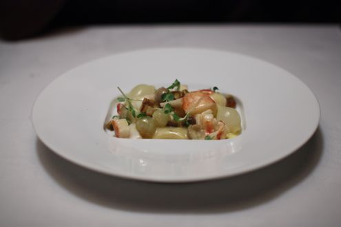 Fricassee of Lobster with Potato Gnocchi, Green Grapes and Curried Walnuts