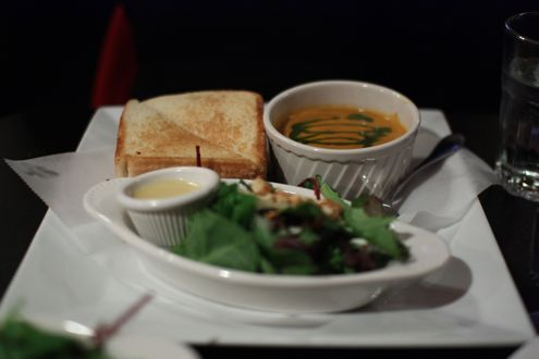 Tomato bisque soup, grilled cheese and bacon sandwich, and side side salad