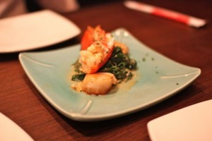 Seared lobster and scallops with mushrooms and spinach