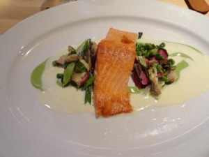 Roasted salmon with english peas, alba mushrooms, and horseradish sauce