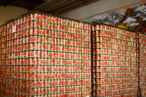 Stack of The Public cans
