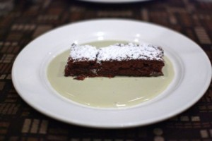 Chocolate cake accompanied with mint crème anglaise