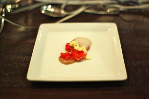 Beef tartar accompanied with egg &quot;caviar&quot; and black truffle