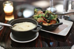 Caramelized brussel sprouts with bacon lardons and truffle mashed potatoes