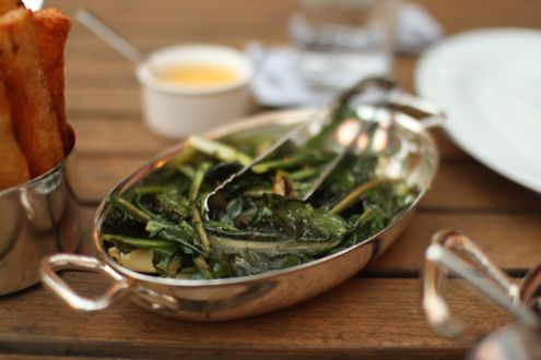 Dandelion greens grilled with fresh garlic and bacon